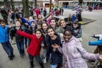 Kinderen op de speelplaats in Stedelijke Basisschool De Zonnebloem