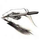 hand met een pen in