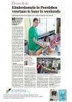 Krantenartikel met leerling die schoep uitschenkt